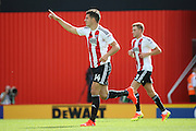 Brentford defender John Egan (14)  celebrating scoring first goal 1-0 during the EFL Sky Bet Championship match between Brentford and Ipswich Town at Griffin Park, London, England on 13 August 2016. Photo by Matthew Redman.