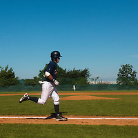 04 June 2010: Maxime Lefevre runs the bases after his back to back home run during the 2010 Baseball European Cup match won 19-9 by Konica Minolta Pioniers over the Rouen Huskies, at the Kravi Hora ballpark, in Brno, Czech Republic.