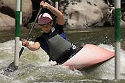 Young woman whitewater kayaking