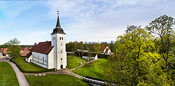 St. John's church in Viljandi, Estonia. Aerial view, trees, walkway, path.
