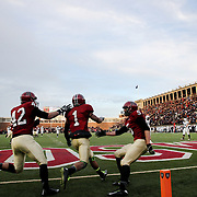 Andrew Fischer, Harvard, (center), celebrates after catching a 35-yard touchdown pass from Conner Hempel for the winning touchdown with 55 seconds to play as Harvard beat Yale 31-24 to capture the Ivy League title outright during the Harvard Vs Yale, College Football, Ivy League deciding game, Harvard Stadium, Boston, Massachusetts, USA. 22nd November 2014. Photo Tim Clayton