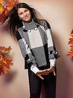 Smiling teenage girl wearing a coat fall fashion photo