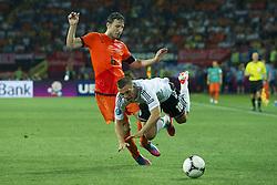 13-06-2012 VOETBAL: UEFA EURO 2012 DAY 6: POLEN OEKRAINE<br /> Mark van Bommel (NED #06) vs Lukas Podolski during the UEFA EURO 2012 group B match between Netherlands en Germany at Metalist Stadium, Charkov, UKR<br /> ***NETHERLANDS ONLY***<br /> ©2012-FotoHoogendoorn.nl