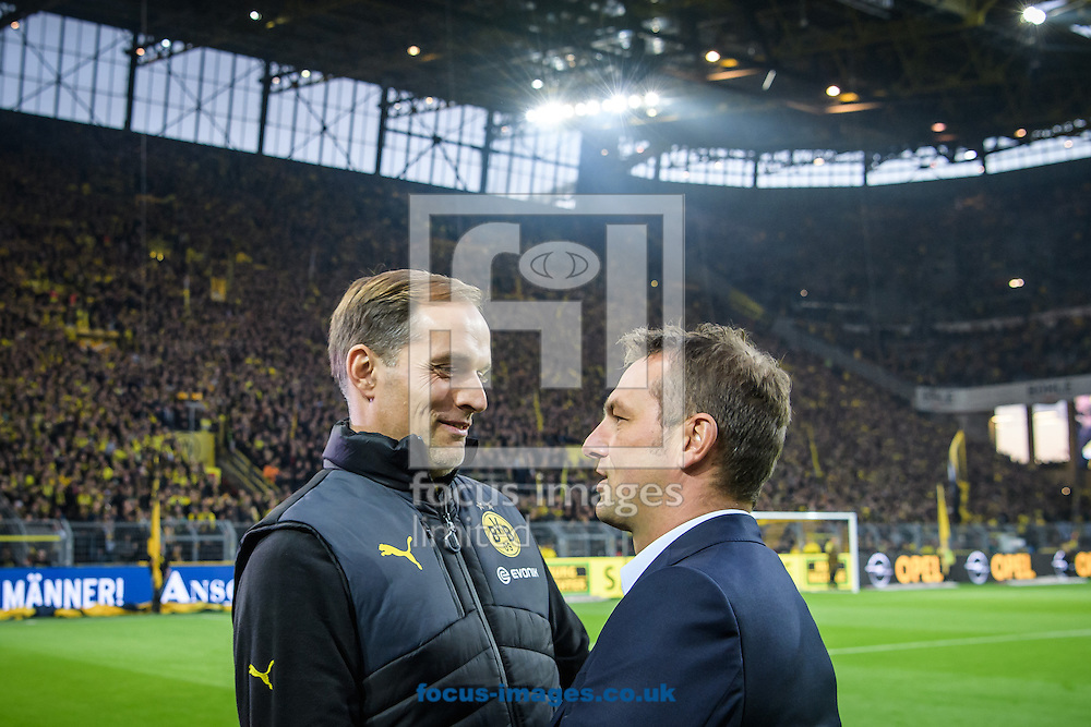 Thomas Tuchel, head coach of Borussia Dortmund and Markus Weinzierl, head coach of FC Schalke 04 during the Bundesliga match at Signal Iduna Park, Dortmund<br /> Picture by EXPA Pictures/Focus Images Ltd 07814482222<br /> 29/10/2016<br /> *** UK &amp; IRELAND ONLY ***<br /> EXPA-EIB-161030-0017.jpg