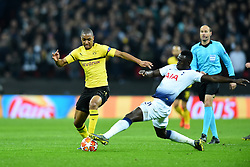 February 13, 2019 - London, England, United Kingdom - Tottenham defender Davinson Sanchez gets a boot in on Borussia Dortmund defender Abdou Diallo during the UEFA Champions League match between Tottenham Hotspur and Ballspielverein Borussia 09 e.V. Dortmund at Wembley Stadium, London on Wednesday 13th February 2019. (Credit: Jon Bromley | MI News & Sport Ltd) (Credit Image: © Mi News/NurPhoto via ZUMA Press)