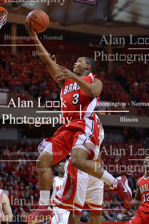 "31 January 2009: Darian Norris reaches out for the hoop, ball in hand. The Illinois State University Redbirds join the Bradley Braves in a tie for 2nd place in ""The Valley"" with a 69-65 win on Doug Collins Court inside Redbird Arena on the campus of Illinois State University in Normal Illinois"