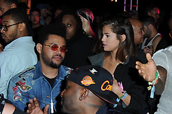 EXCLUSIVE: Selena Gomez and The Weekend are seen at the Neon Carnival in Coachella. 15 Apr 2017 Pictured: Selena Gomez and The Weekend are seen at the Neon Carnival in Coachella. Photo credit: DUTCH / MEGA TheMegaAgency.com +1 888 505 6342