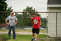 "Kim ""the Outlaw"" watches Steve Zajchowski throws a shoe during the Kip Guay Pete Sevigney annual horseshoe tournament at American Legion Post 1 Saturday.  (Karen Bobotas/for the Laconia Daily Sun)"