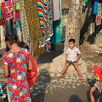 Children play morning games in Horijon Palli. <br /> <br /> All of the residents of Horijon Polli, a slum in Mymensingh are from the low-caste Hindu sweeper community. The community are ostracised from wider society and there are very few employment opportunities for them beyond cleaning. Oxfam are building a latrine block in Horijon Polli and are working with partners NGO Forum to support residents.<br /> <br /> Photo: Tom Pietrasik<br /> Mymensingh, Bangladesh<br /> November 20th 2014