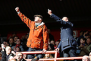 Fans gesture towards the club owners during the Sky Bet Championship match between Charlton Athletic and Middlesbrough at The Valley, London, England on 13 March 2016. Photo by Andy Walter.