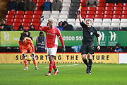 Charlton Athletic attacker Lyle Taylor (9) yellow card during the EFL Sky Bet League 1 match between Charlton Athletic and AFC Wimbledon at The Valley, London, England on 15 December 2018.