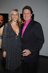 TANYA BRYER and ROD BARKER at a private view of Octagan a showcase of work of photographer Kevin Lynch featuring the stars of the Ultimate Fighter Championship held at Hamiltons gallery, Mayfair, London on 17th January 2008.<br />