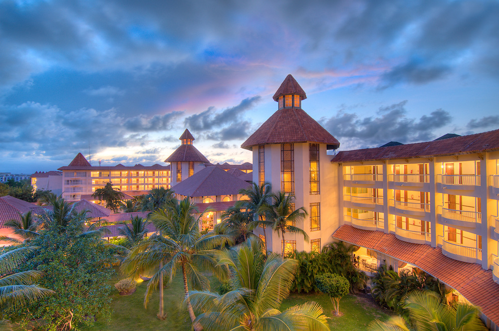 Caribbean, Dominican Republic. Barcelo Premium Punta Cana all inclusive resort at sunset.