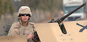 Airman 1st Class Nicole P. O'Hara, Combat Convoy security forces specialist deployed to the 732 Expeditionary Logistics Readiness Squadron, at Balad Air Base, Iraq.  Airman O'Hara and another team member are jointly credited with killing six of the insurgents attacking her convoy that was waiting for an improvised explosive device disposal. Her duties include operating the 50-caliber machine guns on HUMVEEs to M-1083 Medium Tactical Vehicles. O?Hara is assigned to the 1st Security Forces Squadron, Langley Air Force Base, VA. She The Burlington, NC native has logged numerous missions in the high threat zones of Iraq. (U.S. Air Force photo by Master Sgt. Lance Cheung)<br />