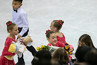 KELOWNA, BC - OCTOBER 26: Figure skaters clear the ice of gifts during the men's long program / free skate of Skate Canada International held at Prospera Place on October 26, 2019 in Kelowna, Canada. (Photo by Marissa Baecker/Shoot the Breeze)