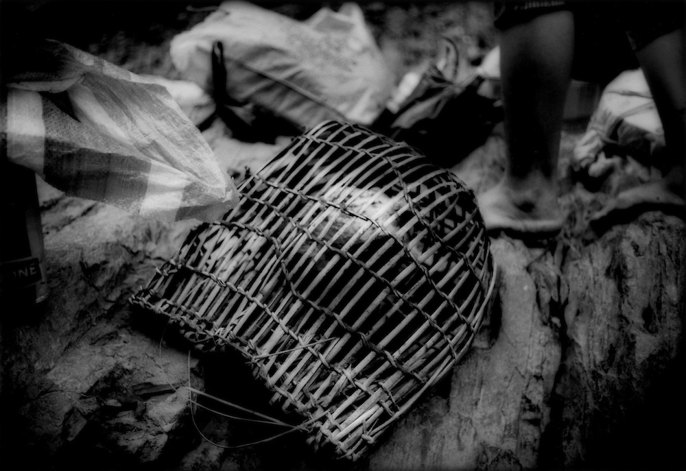 Iban Dayak hunter's rattan backpack used to carry back fish or small prey deep in the rainforest, Sungai Lalang River, Sarawak, Malaysian Borneo.
