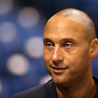 New York Yankees shortstop Derek Jeter (2) talks to teammates prior to a major league baseball game between the New York Yankees and the Tampa Bay Rays at Tropicana Field on Thursday, Sept. 17, 2014 in St. Petersburg, Florida. (AP Photo/Alex Menendez)