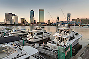 City skyline from the Southbank Riverwalk marina along the St. John's River at sunset in Jacksonville, Florida.