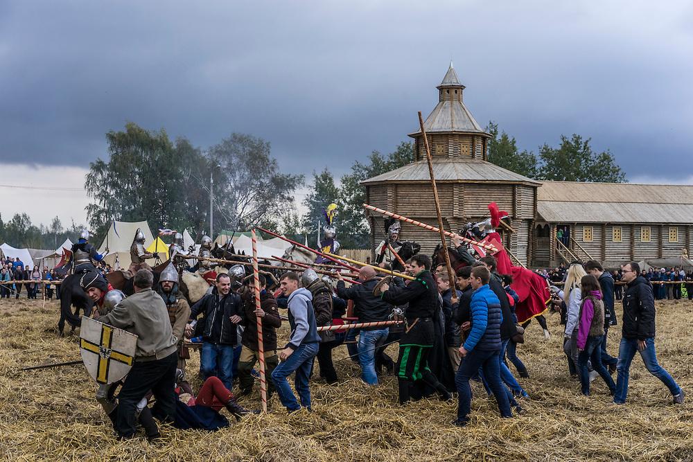 Men dressed in armor put on a fighting demonstration during a medieval festival on Saturday, September 24, 2016 in Mstislavl, Belarus.