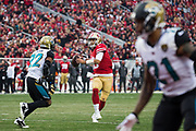 San Francisco 49ers quarterback Jimmy Garoppolo (10) throws the ball against the Jacksonville Jaguars at Levi's Stadium in Santa Clara, Calif., on December 24, 2017. (Stan Olszewski/Special to S.F. Examiner)