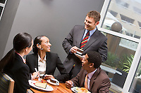 Four business people having lunch
