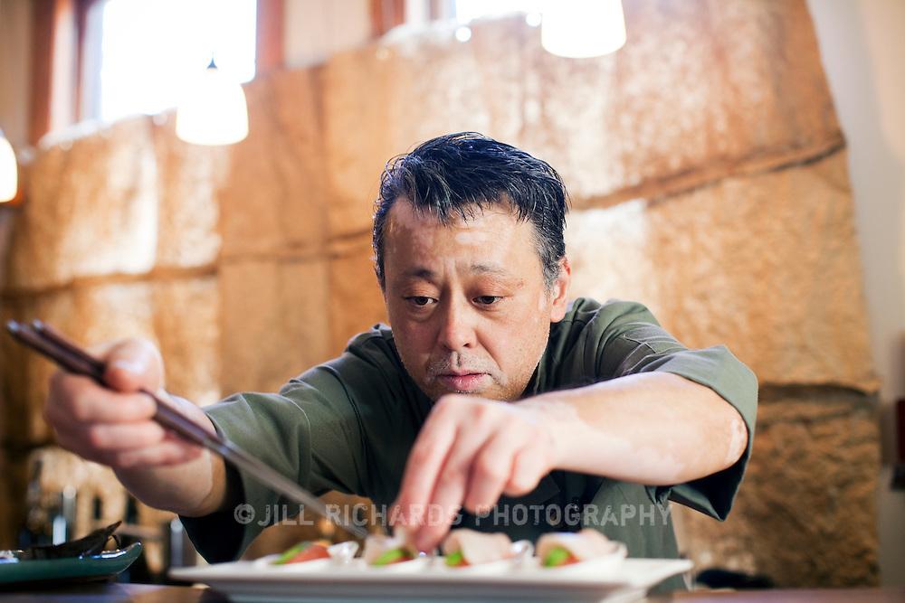 James Beard-award winning chef, Nobuo Fukuda preparing a himachi and grapefruit dish at his restaurant, Nobuo at Teeter House located in Phoenix, Arizona.