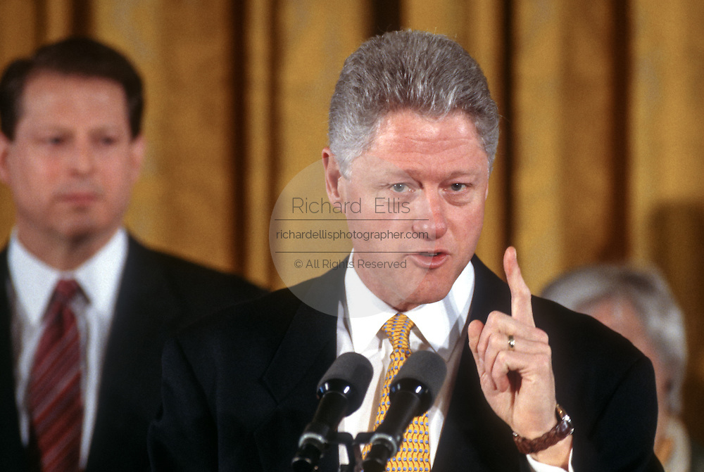 US President Bill Clinton and Vice President Al Gore unveil the first balanced federal budget in the East Room of the White House February 2, 1999 in Washington, DC.