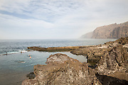 A natural Swimming pool with the giant rock formations in teh background. Acantilados de Los Gigantes, rise from the sea to a height of 500-800 metres.