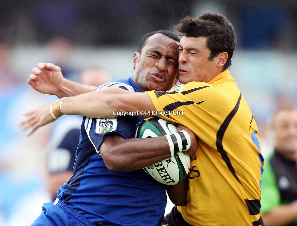 Blues winger Joe Rokocoko clashes heads with Cameron Shepherd during the Super 14 pre-season rugby union match between the Auckland Blues and Western Force at Eden Park, Auckland, on Thursday 2 February, 2006. Photo: Andrew Cornaga/PHOTOSPORT<br />