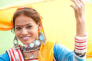 Beautiful  carefree Indian girl in traditional dress smilingto camera.