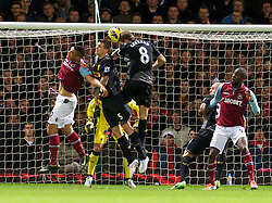 LONDON, ENGLAND - Sunday, December 9, 2012: Liverpool's captain Steven Gerrard scores an own goal to hand West Ham United their second goal during the Premiership match at Upton Park. (Pic by David Rawcliffe/Propaganda)