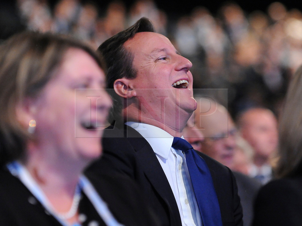 © Licensed to London News Pictures. 03/10/2011. MANCHESTER. UK. The Prime Minister, David Cameron, watches Chancellor George Osborne deliver his keynote speech on the economy to The Conservative Party Conference at Manchester Central today, October 3, 2011. Photo credit:  Stephen Simpson/LNP
