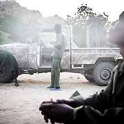 2012-11-20 Au leve du soleil, Nader 19 ans et soldat du SPLA-N (Sudan People Liberation Army North) qui a rejioint l armee a 18 ans, se rememore le temps de paix. La guerre au Sud Kordofan a repris en Juin 2011, suite  a des elections regionales controversees.<br /> Nader n a connu que 6 annees de paix dans sa vie. Tongoli, Sud Kordofan, Soudan.<br /> <br /> Early morning, Nader, 19 year-old rebel who joined the Sudanese People Liberation Army &ndash; North when he was 18 thinks about the time when his region wasn't at war. Nader has only know peace for six years in his life, the rest of it was spent at war. Tongoli, South Kordofan, Sudan - November 2012