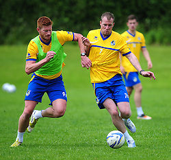 Bristol Rover's Matt Harold and David Clarkson jostle for the ball - Photo mandatory by-line: Dougie Allward/JMP - Tel: Mobile: 07966 386802 24/06/2013 - SPORT - FOOTBALL - Bristol -  Bristol Rovers - Pre Season Training - Npower League Two