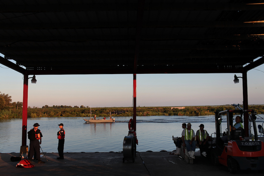 Fishermen at the safety meeting before working picking up the remaining boom around Pelican and Bell Island from Delacroix Island, LA on September 02, 2010.