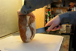 UK ENGLAND BERKSHIRE BRAY 28APR04 - A waiter cuts fresh brown bread at The Fat Duck restaurant in the village of Bray, Berkshire. The Fat Duck recently won the second best award amongst the world's best restaurants and was awarded its third Michelin Star in January.....jre/Photo by Jiri Rezac for Bild am Sonntag....© Jiri Rezac 2004....Contact: +44 (0) 7050 110 417..Mobile:  +44 (0) 7801 337 683..Office:  +44 (0) 20 8968 9635....Email:   jiri@jirirezac.com..Web:    www.jirirezac.com....© All images Jiri Rezac 2004 - All rights reserved.
