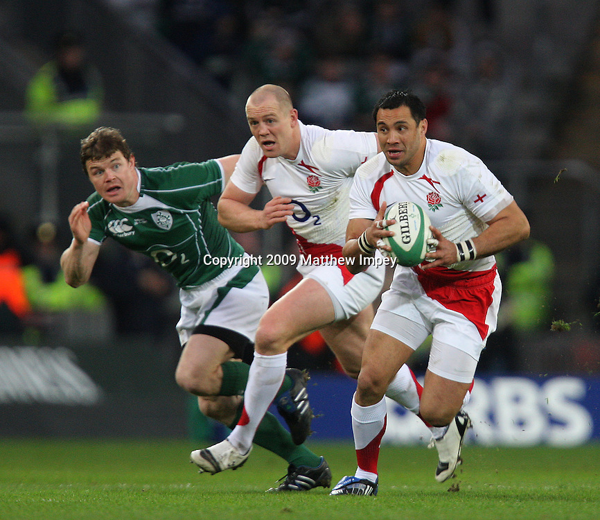 Riki Futey of England runs with the ball supported by Mike Tindall and watched by Brian O'Driscoll of Ireland. Ireland v England, 6 Nations Rugby Championship, Rugby Union, Croke Park, Dublin, 28/02/2009 © Matthew Impey/Wiredphotos.co.uk. tel: 07789 130 347 email: matt@wiredphotos.co.uk