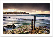 A dark and moody atmosphere at Bondi as heavy summer rain clouds roll in from the sea [Bondi, NSW]<br />