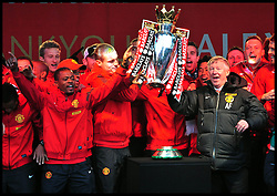 Sir Alex Ferguson Manchester United Fans lifts the trophy to show fans  in Albert Square, Manchester,  As Manchester United celebrate winning their 20th league title winning the Premier League, Monday May 13, 2013. Photo by: Andrew Parsons / i-Images