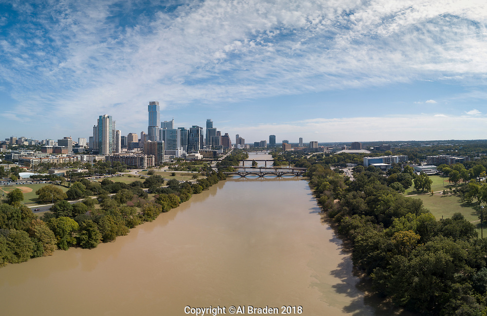 Silt from floods in Colorado River as it meets Barton Creek's clear flow, Ausitn, TX