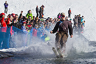 A skier crosses the water during the Wacky Water Event at the Spring  Rally at Mount Peter Ski and Ride in Warwick, New York. The Spring Rally traditionally closes the season at the ski area.