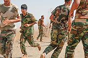 Peshmerga fighters workout in the cool of early morning, at the Mount Batiwa frontline. Iraqi Kurdistan.