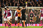 Wolverhampton Wanderers midfielder (on loan from Villarreal) Alfred N'Diaye (4) shown a yellow card,booked  during the EFL Sky Bet Championship match between Aston Villa and Wolverhampton Wanderers at Villa Park, Birmingham, England on 10 March 2018. Picture by Dennis Goodwin.