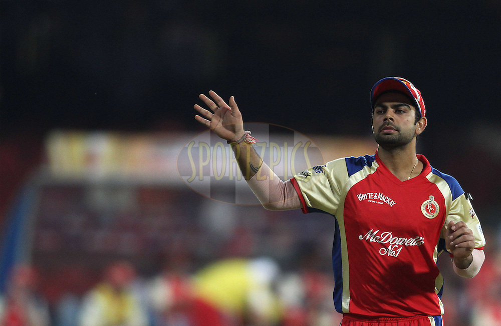 Virat Kohli of Royal Challengers Bangalore during match 1 of the NOKIA Champions League T20 ( CLT20 )between the Royal Challengers Bangalore and the Warriors held at the  M.Chinnaswamy Stadium in Bangalore , Karnataka, India on the 23rd September 2011..Photo by Shaun Roy/BCCI/SPORTZPICS
