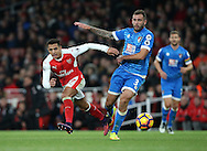 Arsenal's Alexis Sanchez tussles with Bournemouth's Steve Cook during the Premier League match at the Emirates Stadium, London. Picture date October 26th, 2016 Pic David Klein/Sportimage