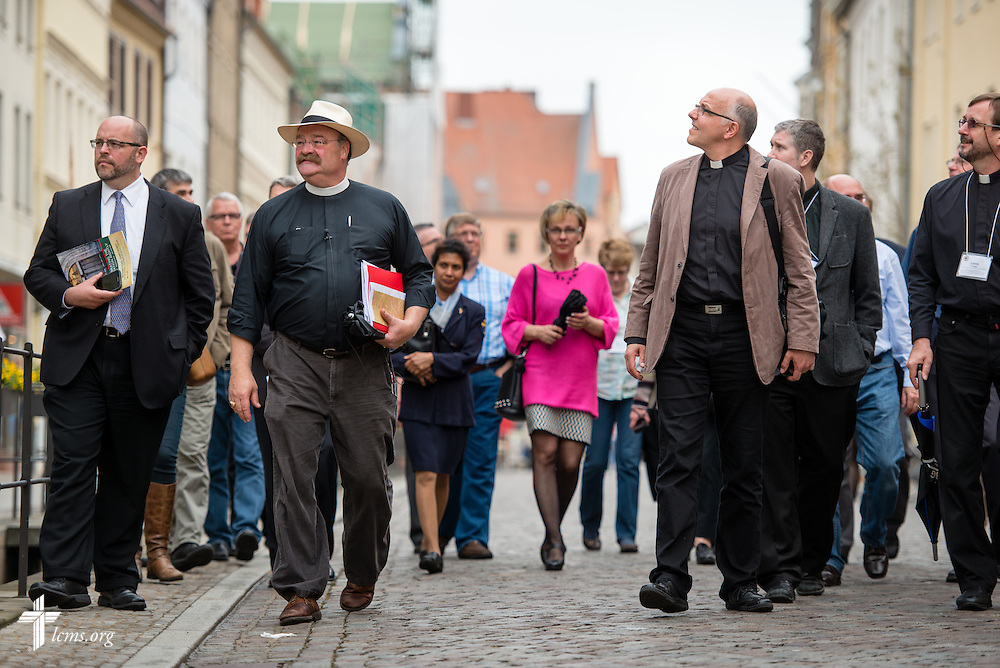The Rev. Dr. Matthew C. Harrison, president of The Lutheran Church–Missouri Synod, leads a tour of Wittenberg, Germany, on Tuesday, May 5, 2015. To the right of Harrison is Bishop Hans-Jörg Voigt of the Independent Evangelical Lutheran Church (SELK). LCMS Communications/Erik M. Lunsford