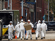 10 MAY 2019 - DAVENPORT, IOWA: Workers remove drywall from a flooded building in Davenport, IA. The Davenport riverfront and downtown flooded on 30 April 2019 when a levee on the Mississippi River failed, allowing the river to flow into Davenport. Parts of downtown are still flooded, nearly two weeks after the levee failed. The river crested at 22.7 feet above flood stage, setting a new record. The previous highest flood stage was 22.63, set in 1993.     PHOTO BY JACK KURTZ