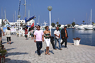 Scenes from Tunisia's resort area, El Kantouai, tourists,strolling through marina