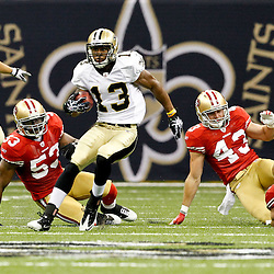 August 12, 2011; New Orleans, LA, USA; New Orleans Saints wide receiver Joe Morgan (13) escapes from San Francisco 49ers defenders NaVorro Bowman (53), Jack Corcoran (43) and Blake Costanzo (51) during the first half of a preseason game at the Louisiana Superdome. Mandatory Credit: Derick E. Hingle