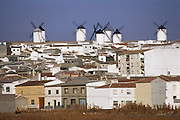 Seven whitewashed windmills above the town of Campo de Criptana, La Mancha, La Mancha, Spain.